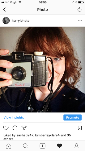 photographer selfie on instagram with vintage camera